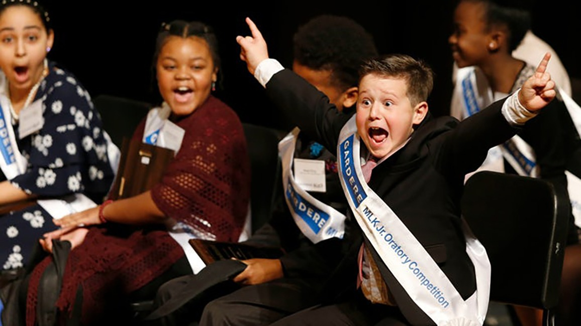 Wesley Stoker celebrates after being announced as the winner of the 26th Annual Gardere MLK Jr. Oratory Competition