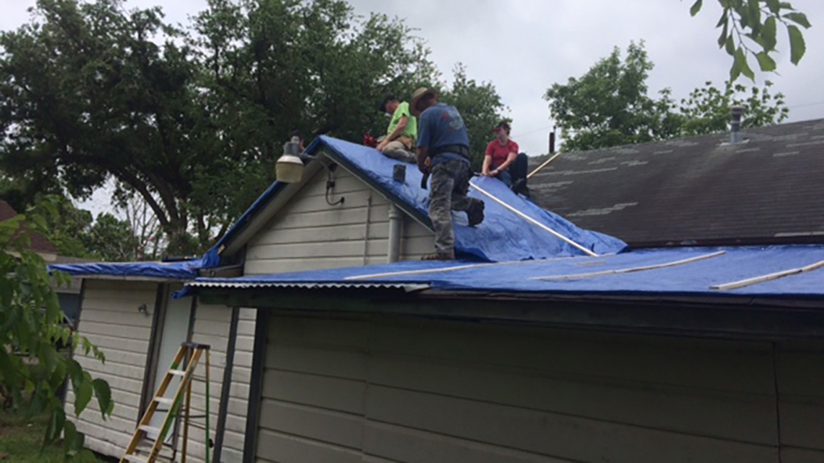 Workers fixing a roof
