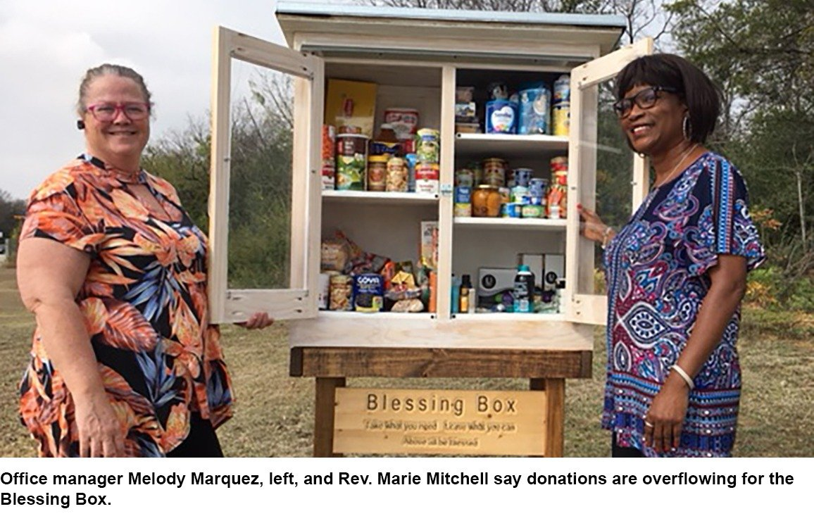 Mary Marquez and Rev. Marie Mitchell with a donation box