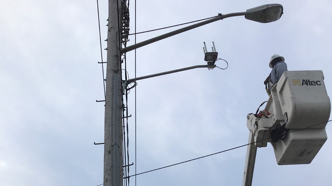 Light pole with router attachment