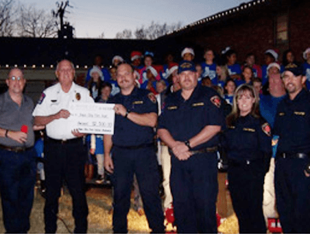 Presenting the check to firefighters